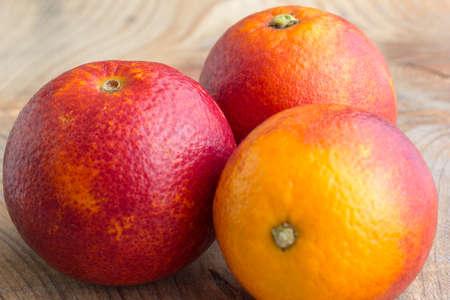orange peel: three Sicilian oranges on a wooden background