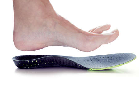 orthopedic insole and female leg above it Standard-Bild