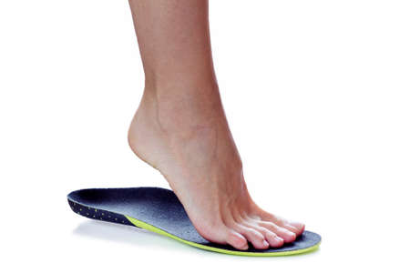female foot stands on their toe in orthopedic insole Stok Fotoğraf