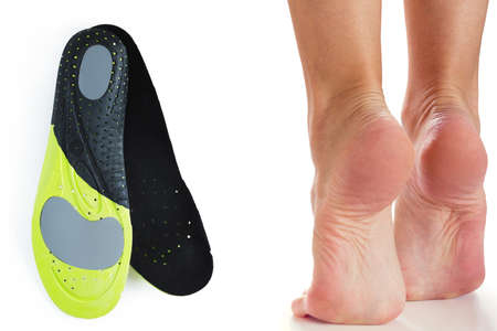 Female feet stand on their toes and orthopedic insoles Reklamní fotografie