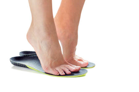 female feet stand on their toes in orthopedic insoles Stockfoto