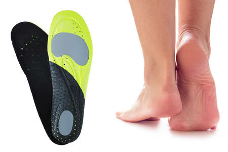 female feet stand on their toes and orthopedic insoles