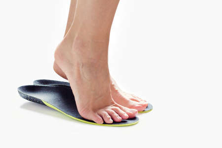 female feet stand on their toes in orthopedic insoles Stock Photo