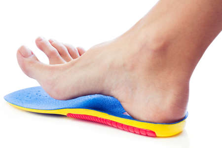 orthopedic insole and female leg above it Stok Fotoğraf