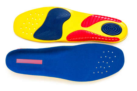 Orthopedic insoles for shoes on a white background