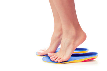 female feet stand on tiptoe in orthopedic insoles Stock Photo