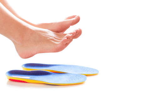 orthopedic insoles and female legs above it Stok Fotoğraf