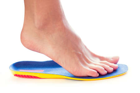 orthopedic insole and female leg above it Banque d'images - 118879711