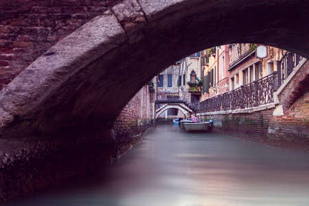 narrow canal in Venice, view from tunnel
