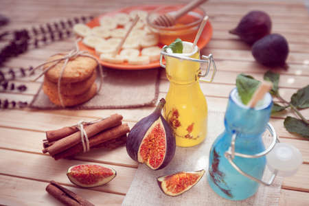 the yogurt decorated with a fig in glass jars and cinnamon, cookie and honey with banana
