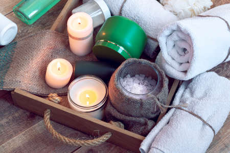 SPA consist from sea salt, towels and other accessories for bath in a wooden tray Reklamní fotografie