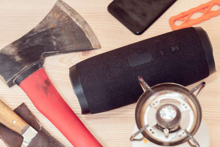 camping set with portable speaker, gas burner and axe 写真素材