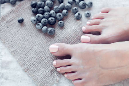 SPA. Skin care of a beauty female feet with pedicure and great bilberry Zdjęcie Seryjne
