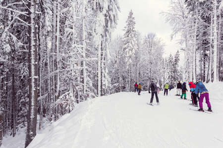 skiers and snowboarders descend down the mountain in winter Stock fotó