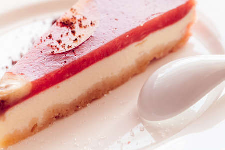 a piece of red cheesecake