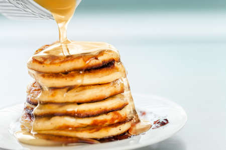 delicious pancakes, spread with honey