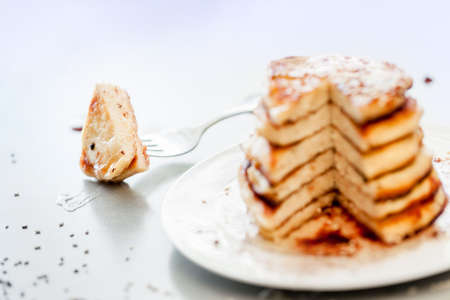 pieces of a delicious pancakes on a heap pancakes background Imagens