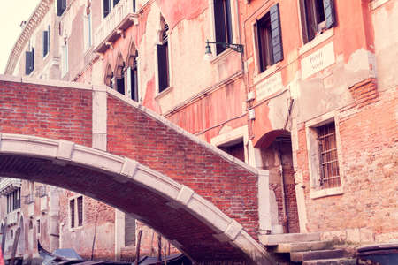 Architecture of the houses with bridge on Ponte Novo street in Venice