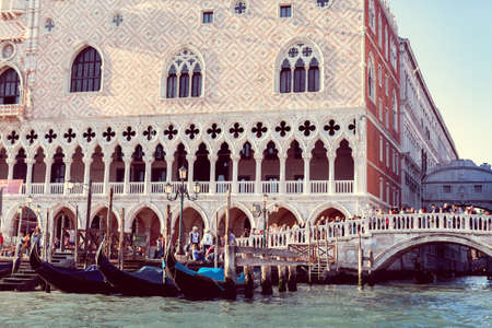 The gondolas on a St. Marks Square background in Venice