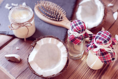 hairbrush and a set of coconut products, from oil and milk for hair care Imagens