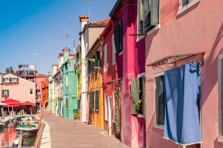 Burano island with colorful houses and canal in the centre
