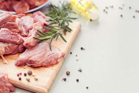 sliced veal with spices and rosemary