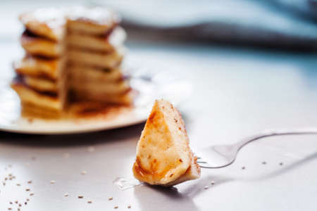 pieces of a delicious pancakes on a heap pancakes background 版權商用圖片