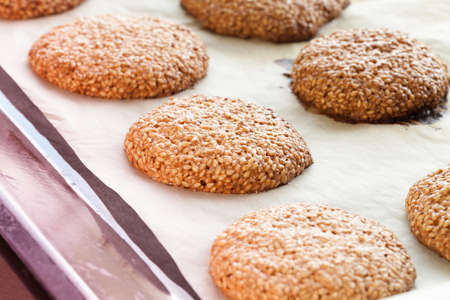 sesame biscuits on parchment paper