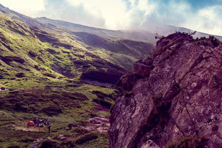 rocky mountain top among the green mountains