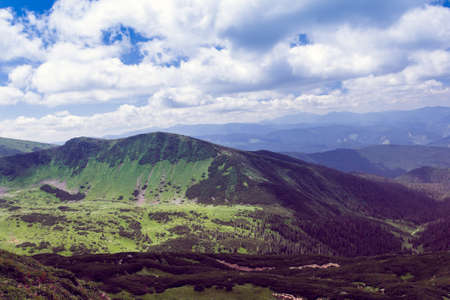 landscape consisting of a Carpathians mountains with green grass