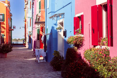 Burano island with colorful houses and paving stones in the centre