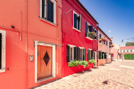 street on a Burano island with colorful houses Stok Fotoğraf
