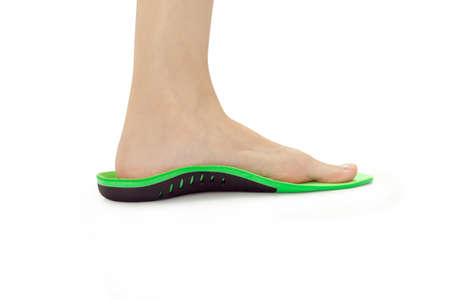 orthopedic insole and female leg in it