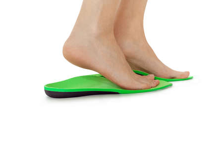 female feet stand in orthopedic insoles