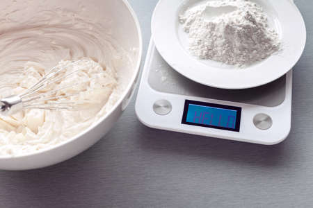 kitchen scales measure the mass of flour for making biscuit. Inscription on kitchen scales display:
