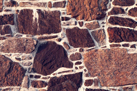 brown stone wall from cobblestone as a background