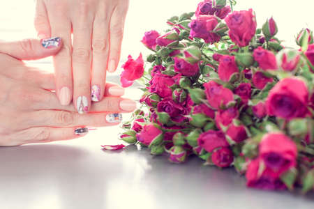 Skin care of a beautiful female hands with art nail manicure. 版權商用圖片 - 147023250