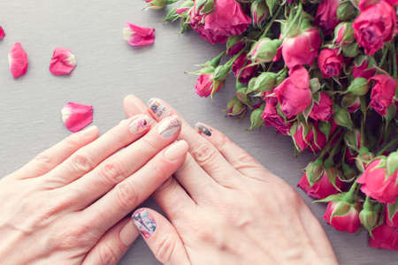 Skin care of a beautiful female hands with art nail manicure.