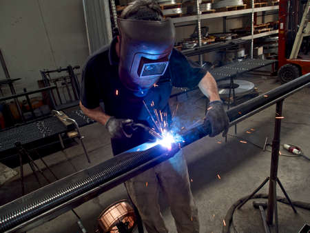 uses: Solderer USES PROTECTIVE MASK Stock Photo
