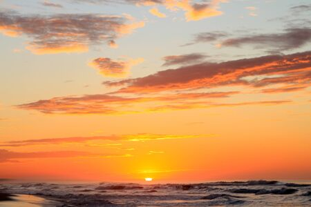 Dramatic Tropical Sunrise over Pacific Ocean and Sandy Beach Reklamní fotografie