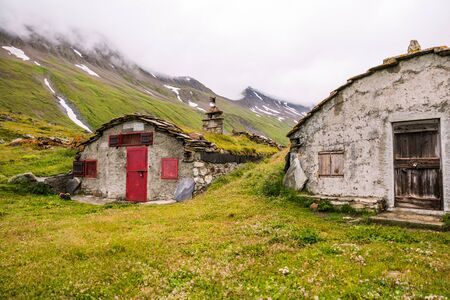 Mountain Stone Huts on Iconic Mont-Blanc Trail on a Cloudy Day