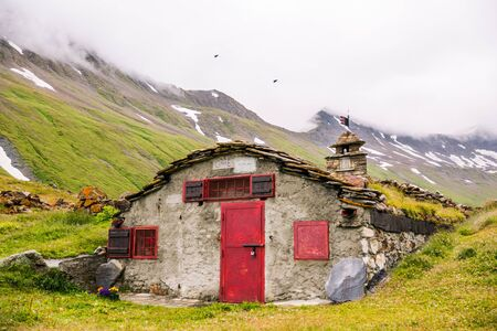 Mountain Stone Huts on Iconic Mont-Blanc Trail on a Cloudy Day Reklamní fotografie