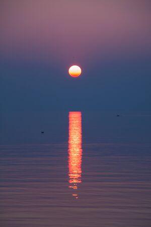 Crimson and Purple Sunset Reflecting in Lake Leman