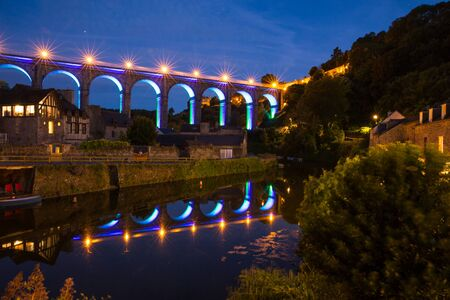Illuminated Aquaduct in Dinan Reflecting in Rance River at Night in Bretagne, Cotes d'Armor, France