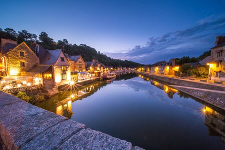 Dinan and Medieaval Stone Houses Reflecting in Rance River at Dusk in Summer in Bretagne, Cotes d'Armor, France