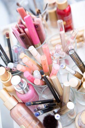 Multi Coloured Make-up (Foundation, Blush, Mascara and Lipsticks) on a Beautician Table