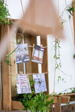 Suspended Wood Pallet and Crates Decorated with Rope and Wedding Photos