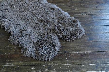 wooden floors: The sheepskin rug on the old wooden floor