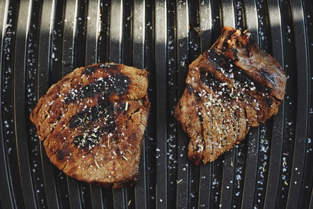 Tasty fresh grilled meats with spices and salt