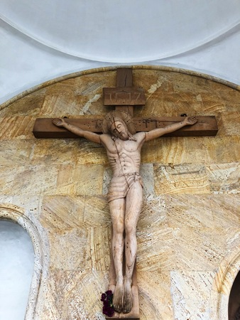 Beautiful wooden sculpture of Jesus and cross
